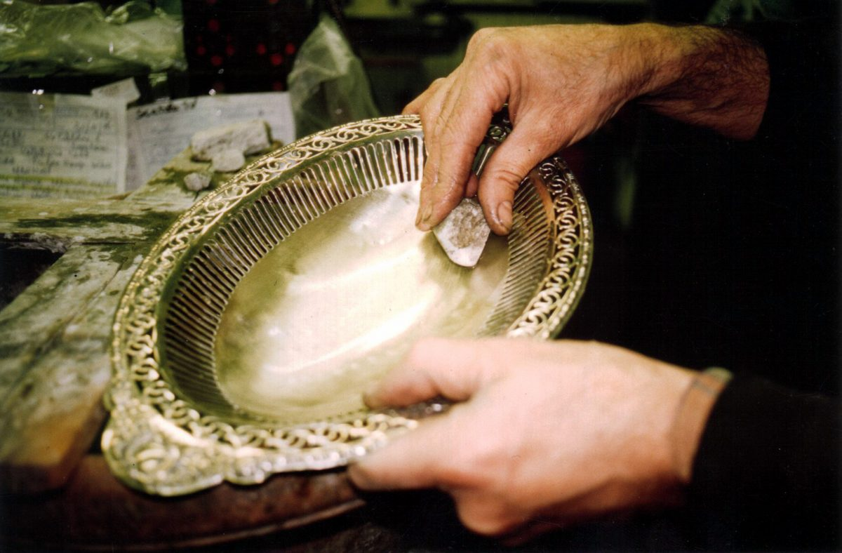 Silver restoration silver basket and hands