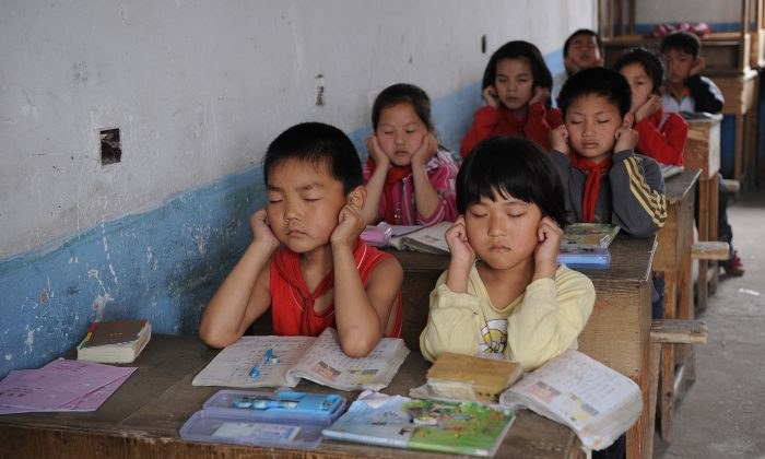 Chinese schoolchildren attend a class at a rural elementary school in Hefei, central China's Anhui province on May 12, 2010. (STR/AFP/Getty Images)