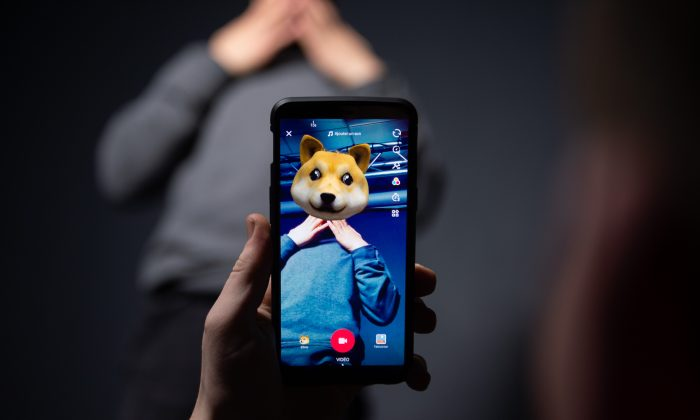 An AFP collaborator poses for a picture using the smart phone application TikTok  in Paris, France, on Dec. 14, 2018. (AFP/Getty Images)