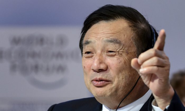 Huawei Founder and CEO Ren Zhengfei gestures as he attends a session of the World Economic Forum (WEF) annual meeting on Jan. 22, 2015 in Davos.   (AFP photp/ Fabrice Coffrini)