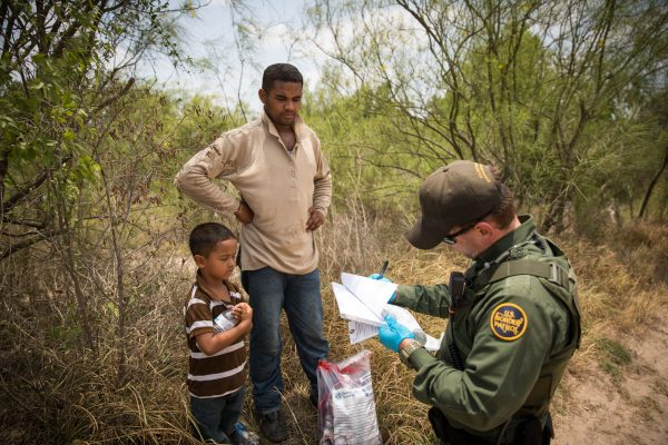 Border Patrol Agent takes down information