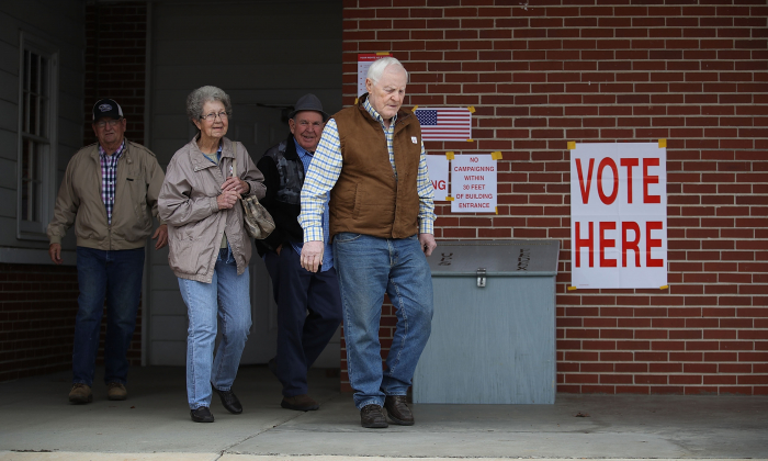 Voters exit after casting their ballots at a polling station setup in the Fire Department in Gallant, Alabama, on Dec. 12, 2017. (Joe Raedle/Getty Images)