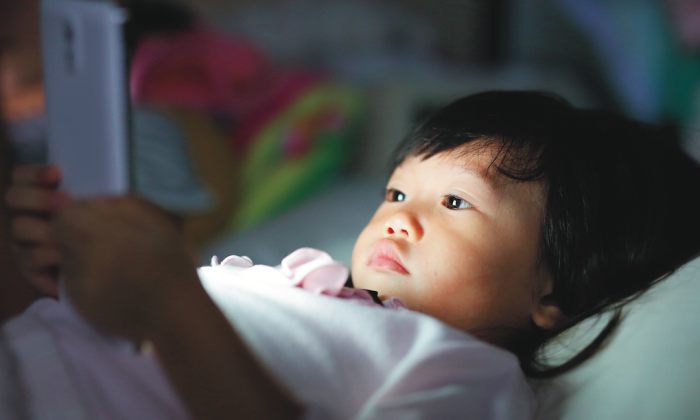 Emerging research shows screen usage actually impedes the development of basic abilities like building vocabulary. (GOLFX/Shutterstock)