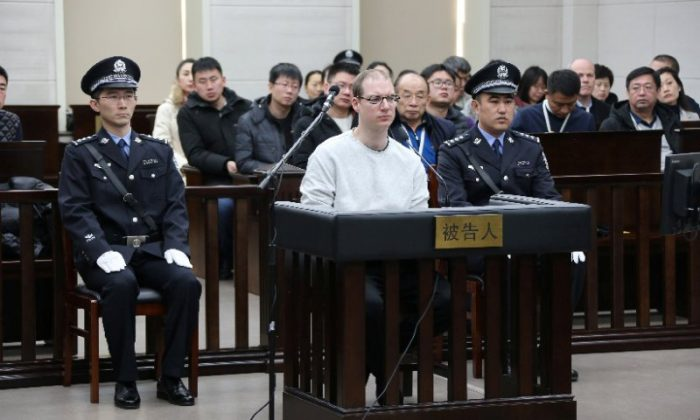 Canadian Robert Lloyd Schellenberg appears in court for a retrial of his drug smuggling case in Dalian, Liaoning province, China, on Jan. 14, 2019. (Handout via REUTERS)