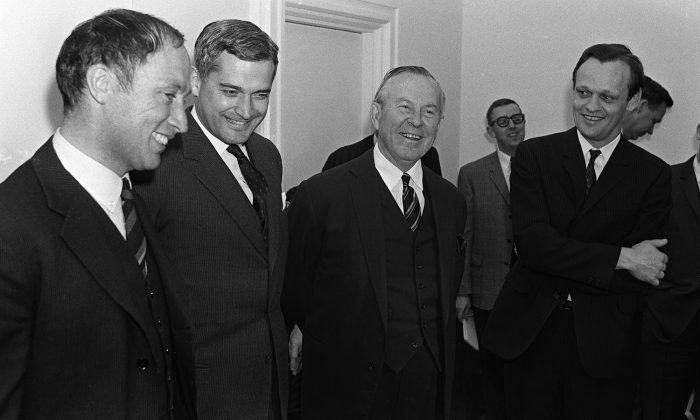 Prime Minister Lester B. Pearson (second right) and cabinet ministers Pierre Trudeau (left to right) John Turner and Jean Chretien talk in Ottawa, on April 4, 1967. (The Canadian Press/Chuck Mitchell)
