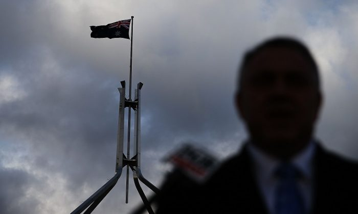 File photo of silhouette of an Australian politician in front of Australia's Parliament House in Canberra. (Stefan Postles/Getty Images)