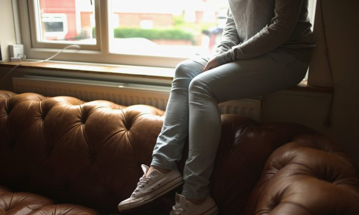 A teenage girl who claims to be a victim of sexual abuse and alleged grooming in Rotherham, United Kingdom, on Sept. 3, 2014. (Christopher Furlong/Getty Images)