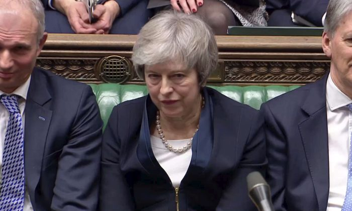 Prime Minister Theresa May sits down in parliament after the vote on May's Brexit deal, in London on Jan. 15, 2019. (Reuters TV via Reuters)
