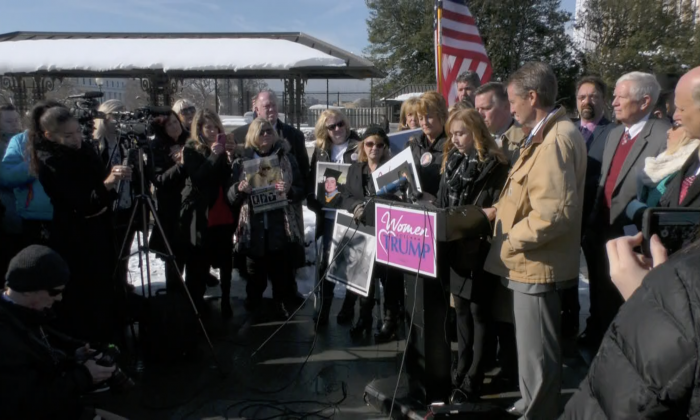 A coalition of angel families, Women for Trump,  congress members, families who have lost loved ones to drug overdoses, war, and 9/11, rallied outside the Capitol in Washington on Jan. 15, 2019, to show their support for President Donald Trump and his request to build a wall on the southwest border. (York Du/NTD)