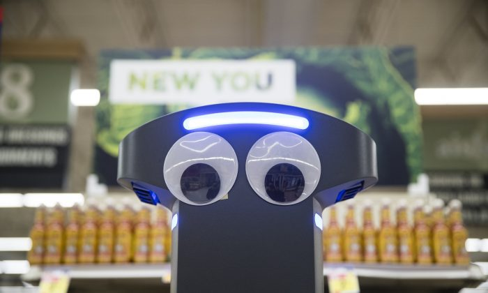 A robot named Marty cleans the floors at a Giant grocery store in Harrisburg, Pa., on Jan. 15, 2019. (AP Photo/Matt Rourke)