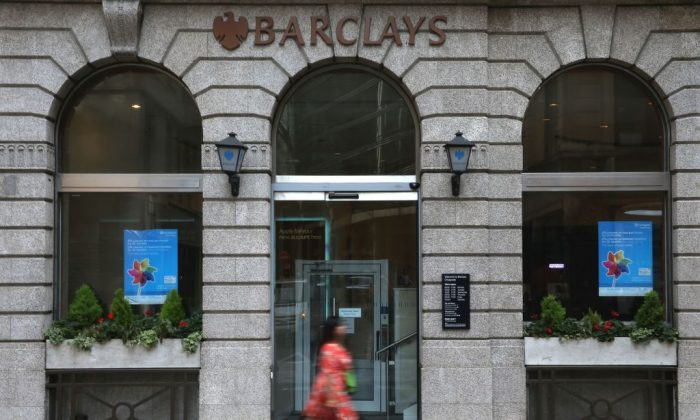 A pedestrian walks past a branch of Barclays bank in central London on July 25, 2018. (Daniel Leal-Olivas/AFP/Getty Images)