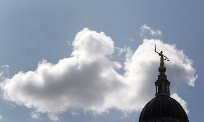 "The Lady of Justice on top of the ""Old Bailey"" Central Criminal Court in London on July 10, 2009. (Stephen Hird/Reuters)"