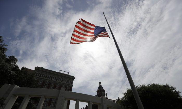 A flag flies at half-staff over Dealey Plaza in Dallas in a July 9 file photo. (AP Photo/Eric Gay)