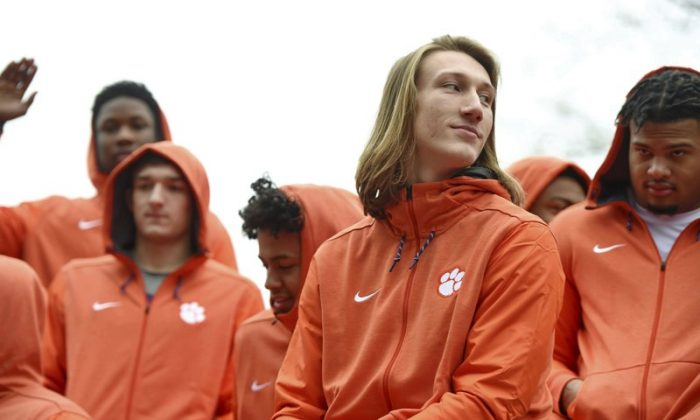 Clemson quarterback Trevor Lawrence, foreground, and fellow freshmen ride in the parade honoring the football team, in Clemson, S.C., after the Tigers defeated Alabama 44-16 in the NCAA College Football Playoff championship on Jan. 12, 2019. (Richard Shiro/AP Photo, File)