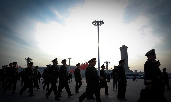 Chinese military officials arrive at the Great Hall of the People before a session of China's rubber-stamp legislature, the National People's Congress, in Beijing on March 12, 2015.  (Lintao Zhang/Getty Images)