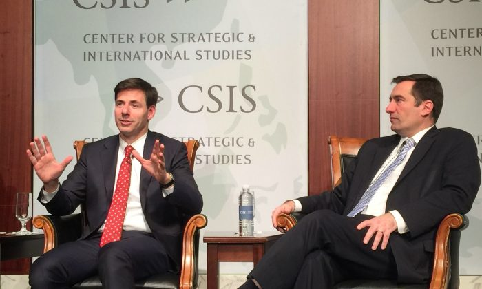 "Former Assistant Attorney General John Carlin (L) and Assistant Attorney General John Demers appear in the panel ""Dawn of the Code War"" at the Center for Strategic and International Studies in Washington on Jan. 15, 2019. (Jennifer Zeng/The Epoch Times)"