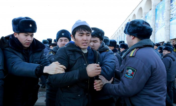 Police officers detain protester against the rising Chinese presence in the country in Bishkek, Kyrgyzstan on Jan. 17, 2019. (Reuters)