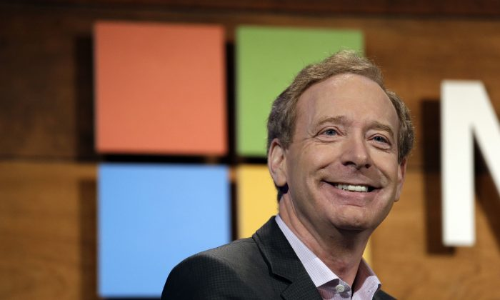 Microsoft's Brad Smith, president and chief legal officer, speaks at the annual Microsoft shareholders meeting in Bellevue, Wash., on Nov. 30, 2016. (Elaine Thompson/AP)