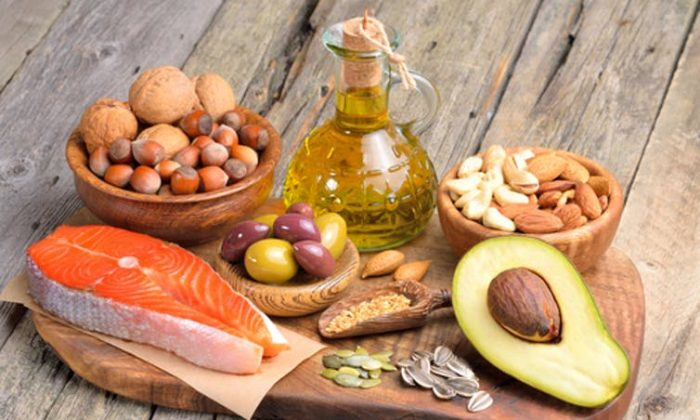 A mix of fats, such as those found in nuts, avocados, salmon and olives, could be healthy and more satisfying. (Craevschii Family/Shutterstock)