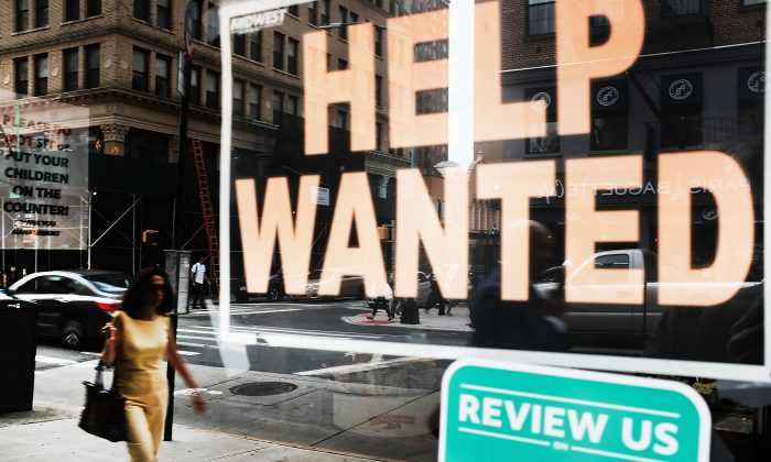 A help wanted sign is displayed in the window of a Brooklyn business in New York on Oct. 5, 2018. (Spencer Platt/Getty Images)