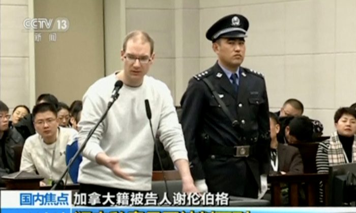 A still image taken from CCTV video shows Canadian Robert Lloyd Schellenberg in court, where he was sentenced with a death penalty for drug smuggling, in Dalian, Liaoning province, China, on Jan. 14, 2019. (CCTV via Reuters)