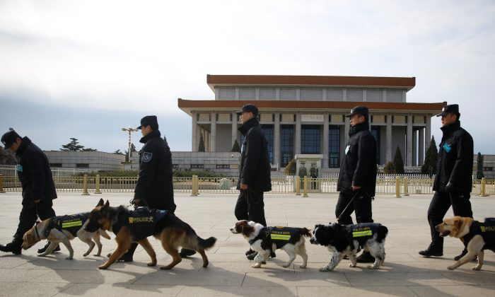 Police walk sniffer dogs outside the Great Hall of the People during the closing session of the Chinese People's Political Consultative Conference (CPPCC) in Beijing on March 15, 2018. (Thomas Peter/Reuters)