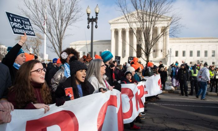 "Pro-life supporters participate in the ""March for Life,"" an annual event to mark the anniversary of the 1973 Supreme Court case Roe v. Wade, which legalized abortion in the U.S., outside the U.S. Supreme Court in Washington, Jan. 18, 2019. (SAUL LOEB/AFP/Getty Images)"