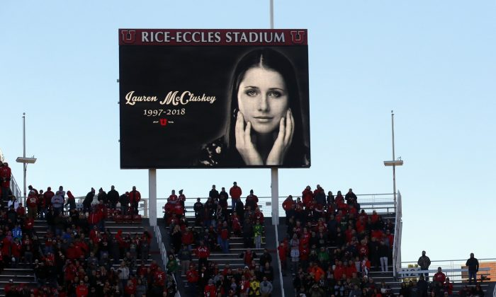 A photograph of University of Utah student and track athlete Lauren McCluskey, who was fatally shot on campus, is projected on the video board before the start of an NCAA college football game between Oregon and Utah in Salt Lake City on Nov. 10, 2018. (Rick Bowmer/AP)