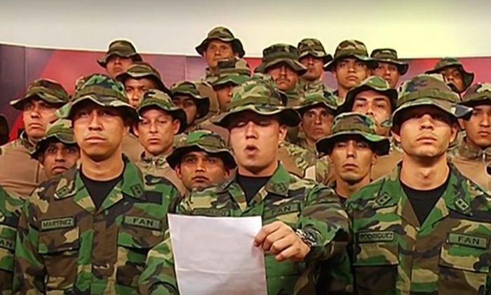 Venezuelan soldiers gathered to read their statement. (Screenshot/Reuters)