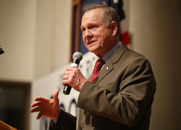 Roy Moore speaking with microphone in hand