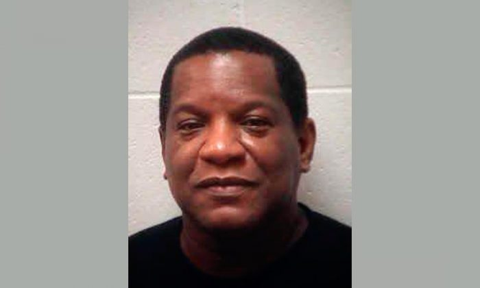 Henry James Mason under arrest in GA. Mason turned himself in after he threatened a father who says singer R. Kelly is keeping his daughter from her family, on Jan. 18, 2019. (Henry County Sheriff's Office via AP)