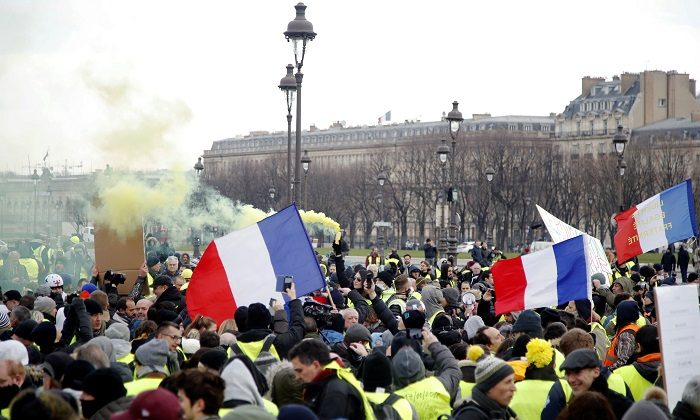 "Protesters wearing yellow vests take part in a demonstration by the ""yellow vests"" movement, in Paris, France, on Jan. 19, 2019. (Charles Platiau/Reuters)"