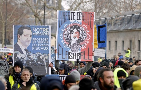 "Protesters wearing yellow vests take part in a demonstration by the ""yellow vests"" movement, in Paris"
