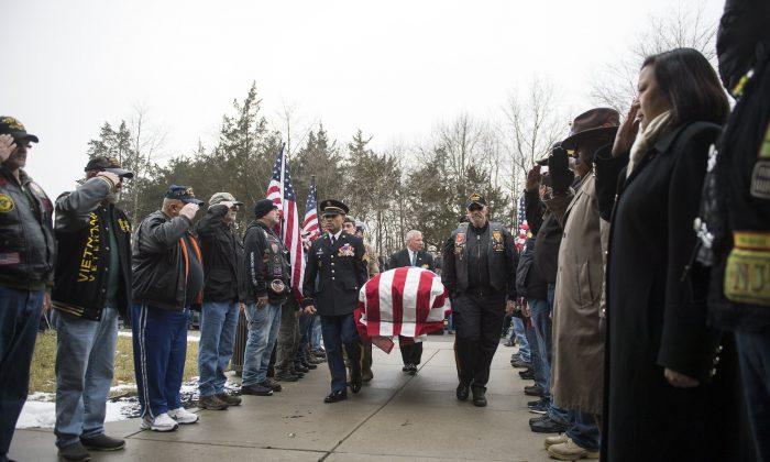 Pall bearers carry the casket of Vietnam veteran Peter Turnpu as hundreds of strangers gather for a funeral in Wrightstown, New Jersey on Jan. 18, 2019. (Joe Lamberti/Camden Courier-Post via AP)