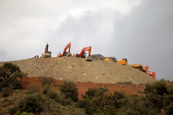 Idle diggers and trucks are seen after removing sand at the area where Julen, a Spanish two-year-old boy fell into a deep well six days ago, in Totalan