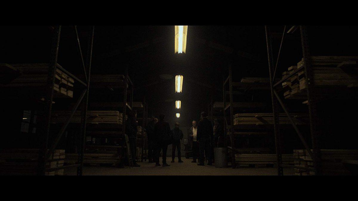 Militia meeting in a dark warehouse