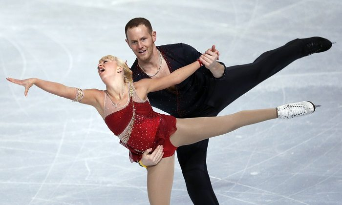 Caydee Denney and John Coughlin, of the United States, perform during their Pairs Short Program during the ISU Figure Skating Eric Bompard Trophy at Bercy arena in Paris, on Nov. 15, 2013. (Francois Mori/AP Photo/File)