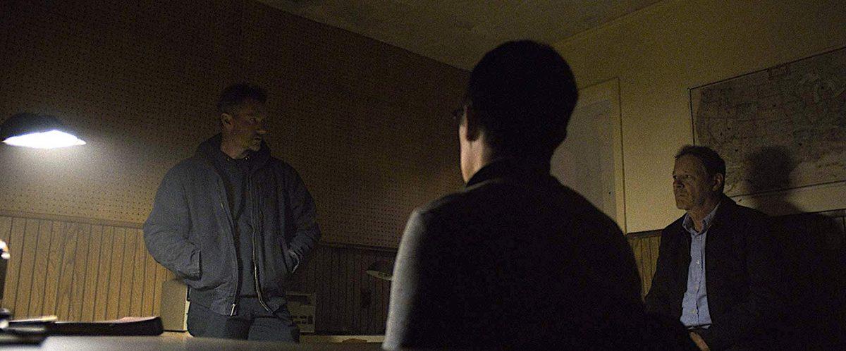 Three militia men in a dark room