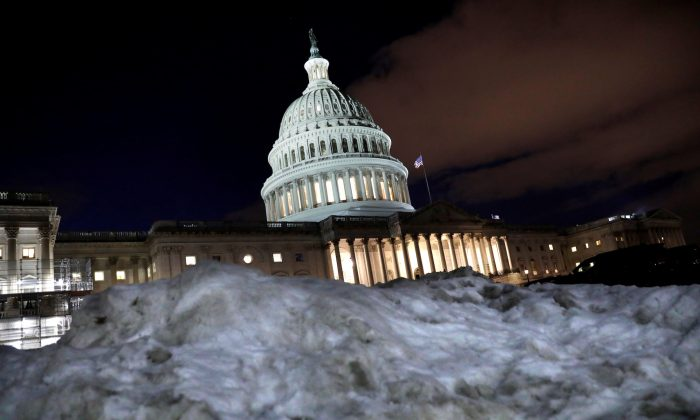 The U.S. Capitol is seen behind a snow pile in Washington, U.S., Jan. 16, 2019. (Yuri Gripas/REUTERS)