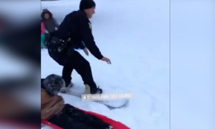 A police officer in Toledo, made the most of a winter storm hitting the state by getting snowboarding tips. Ohio, Jan. 19 (Toledo Police Department)