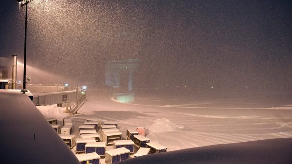 Airline baggage carts sit on the tarmac as crews prepare to remove snow at the Albany International Airport on Jan. 20