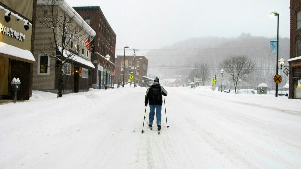 Bill Moore cross-country skis down a street on Jan. 20