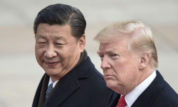 President Donald Trump and Chinese leader Xi Jinping in Beijing on Nov. 9, 2017. (Fred Dufour/AFP/Getty Images)
