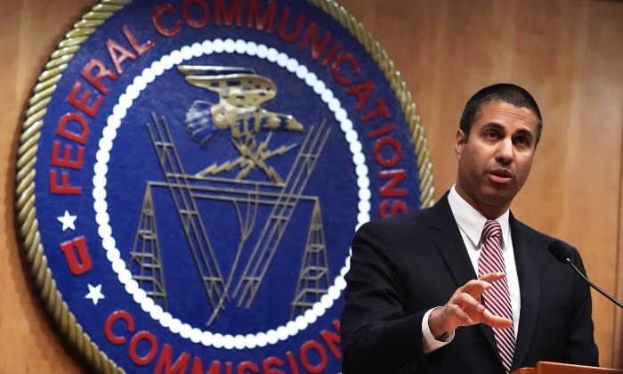 Federal Communications Commission Chairman Ajit Pai speaks to members of the media after a commission meeting in Washington on Dec. 14, 2017. (Alex Wong/Getty Images)