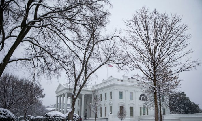 Snow falls around the White House, on January 13, 2019 in Washington, DC. President Donald Trump is holding off from a national emergency declaration to fund a border wall amidst the longest partial government shutdown in the nation's history. (Al Drago/Getty Images)