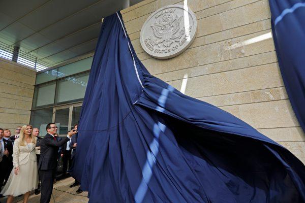 Treasury Secretary Steve Mnuchin and Ivanka Trump unveil an inauguration plaque during the opening of the U.S. Embassy in Jerusalem