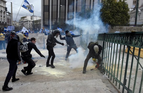 Protesters throw smoke grenades