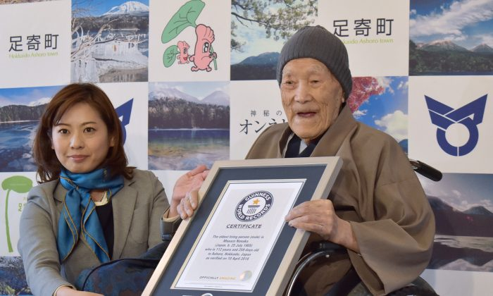 File—Masazo Nonaka receiving a certificate for the Guinness World Records oldest man living title at a ceremony in Ashoro, Japan, on April 10, 2018. Nonaka died on Jan. 20, 2019, aged 113. (Jiji Press/AFP/Getty Images)