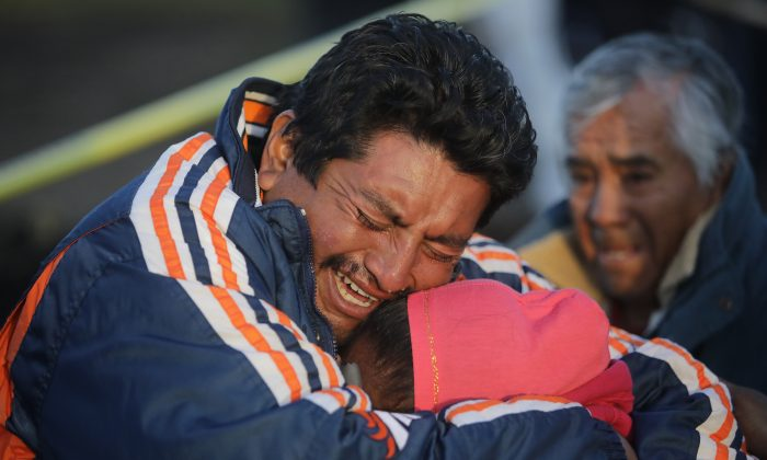 Family members of a victim cry when recognizing the body after an explosion in a pipeline belonging to Mexican oil company PEMEX on Jan. 19, 2019 in Tlahuelilpan, Mexico. (Hector Vivas/Getty Images)