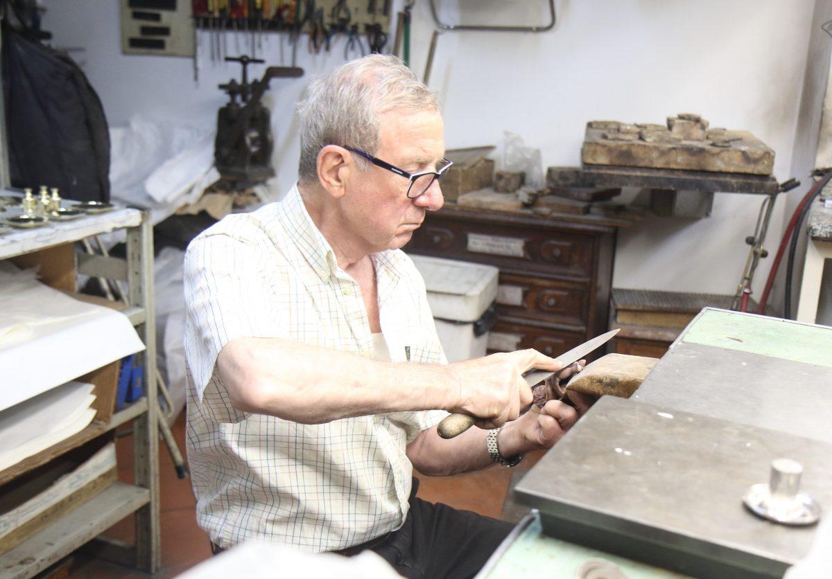 Bronze cherub silversmith hand craft
